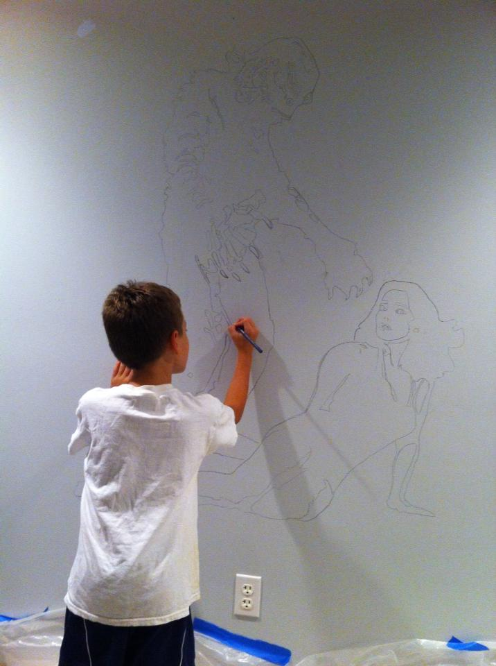 "Ben working on ""The Creature from the Black Lagoon"" mural."